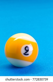 Billiard pool game nine ball on billiard table with blue cloth, copy space