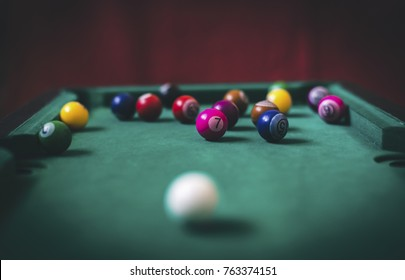 Billiard pool on the background of the billiard table