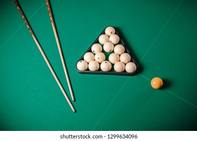 Billiard Russian table and cue with white balls.