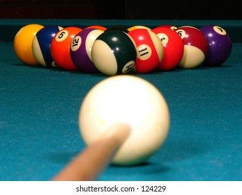 A billiard stick and cue ready to break (eye level)