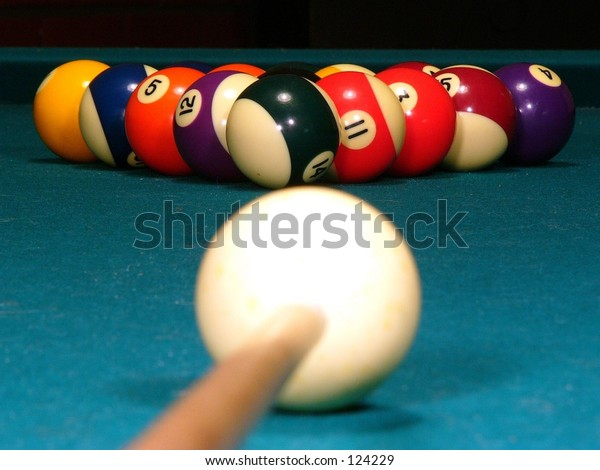 A billiard stick and cue ready to break (eye level)