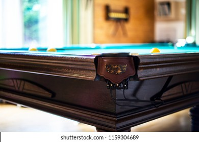Billiard table close up. Playing billiard. Billiards balls and cue on green billiards table. Billiard sport concept. Pool billiard game.