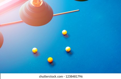Billiard table close up. Playing billiard. Billiards balls and cue on green billiards table. Billiard sport concept. Pool billiard game. Home interior.