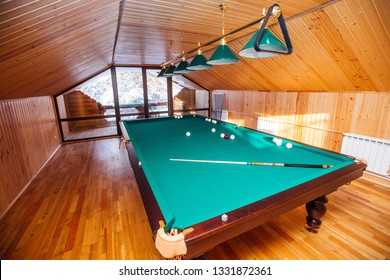 billiard table in a wooden house