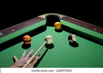 Billiards balls and cue on billiards table. Playing Billiards on green table.