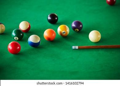 Billiards balls on green table
