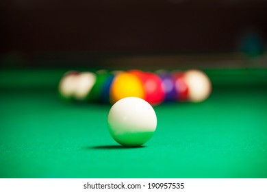 Billiards. Billiard balls on green table and white ball on the foreground
