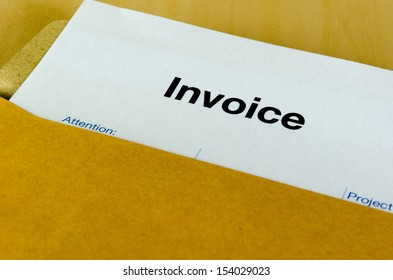 Billing invoice in the envelope on the table.