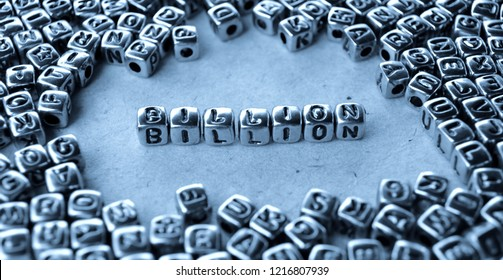 Billion - Word from Metal Blocks on Paper - Concept Photo on Table