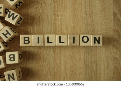 Billion word from wooden blocks on desk