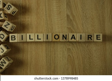 Billionaire word from wooden blocks on desk