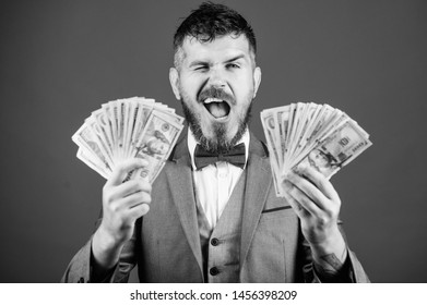 Billioner with dollar banknotes. Business and sport success. winning a lottery. businessman after great deal. Finance and commerce. happy bearded man has a lot of money. successful day at the office.