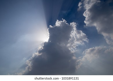 Billowing clouds block the beaming sun.