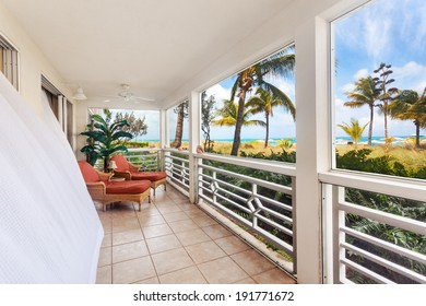 Billowing white curtains on a sunny screen in porch with an oceanfront view