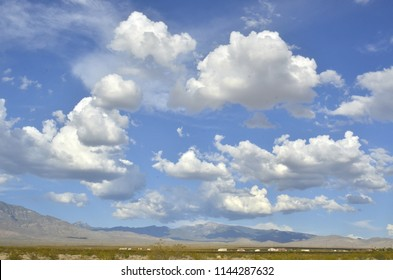 billowy white and gray clouds over desert in Pahrump, Nevada, USA