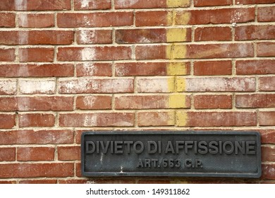 billposting prohibition sign on a brick wall in Italy