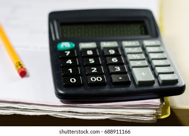 Bills, documents and papers with calculator. Office of the accounting office. Wooden table.