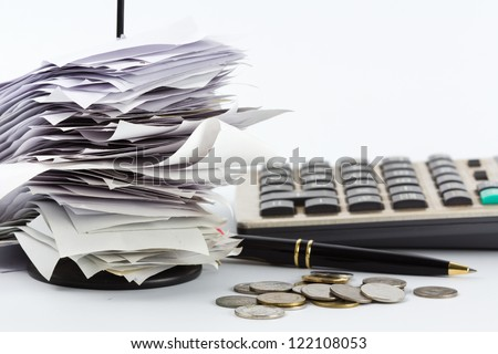Bills in paper nail on business desk
