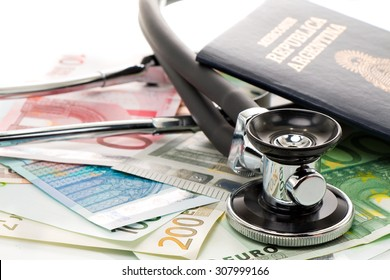 Bills with stethoscope and passport, isolated