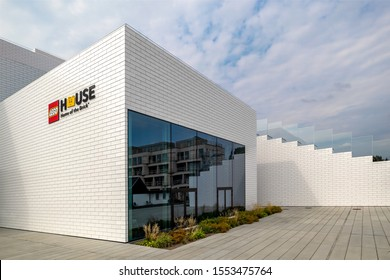 BILLUND, DENMARK - AUGUST 16 2019: The LEGO House experience centre with the venue's logo. Designed by Bjarke Ingels Group. Big outdoor staircases lead to colorful terrace-playgrounds and the rooftop.