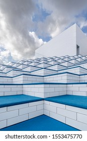 BILLUND, DENMARK - AUGUST 16 2019: Exterior of the LEGO House experience centre. Its giant staircases lead to colorful terrace-playgrounds and a rooftop terrace. Designed by Bjarke Ingels Group (BIG).