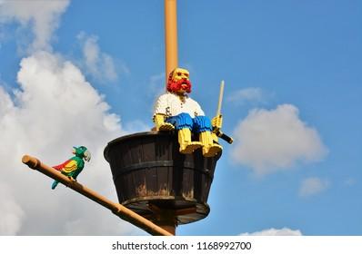 Billund, Denmark - August 2018: Pirate and parrot made of bricks at LEGOLAND in Billund, Denmark