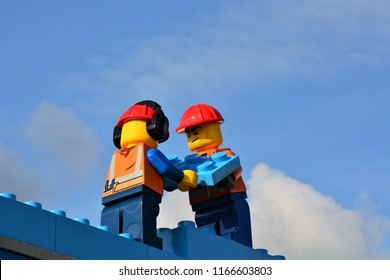 Billund, Denmark - August 2018: Two construction workers figures on a display at Legoland
