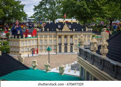 Billund, Denmark - July 27, 2017:  Amalienborg royal palace made of lego bricks, royalty residence. People admiring the Lego city in Legoland, Denmark