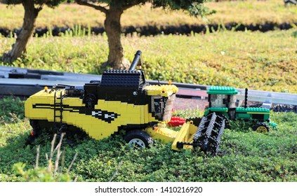 Billund, Denmark, May, 23, 2019: Legoland, Harvester and Tractor in the field