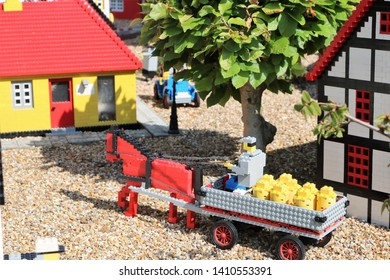 Billund, Denmark, May, 23, 2019: Legoland Resort, horsed carriage with milk tanks, carter.