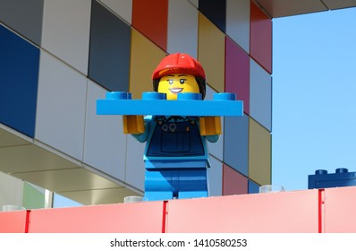 Billund, Denmark, May, 23, 2019: Legoland Resort, Amusement Park, Big Lego Woman Builder with a lego block at the exit from the park.