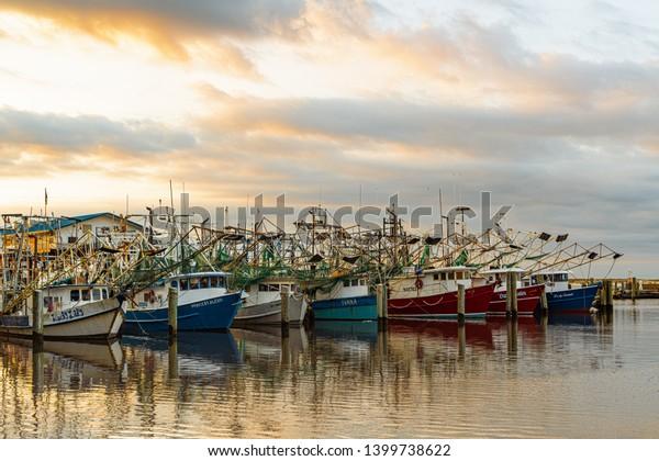 Biloxi Mississippi, USA, May/15/2019. Early morning photograph of shrimp boats in Biloxi harbor