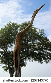 """""""Biloxi, MS / USA - October 9, 2018 : Wooden Crane on I 90 carved from a dead tree by Hurricane Katrina in Biloxi, MS"""""""