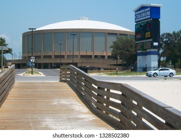 Biloxi,MS / USA (5-21-2011):  The Mississippi Coast Coliseum, located on Beach Blvd, with pier leading out to the beach, there on the Gulf of Mexico.
