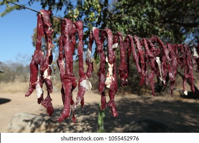 Biltong jerky meat drying in the sun
