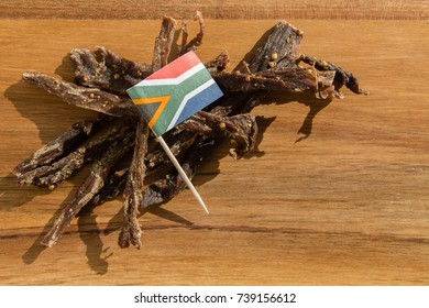 Biltong on a wooden board, this is a traditional food snack that can be found in South Africa.This image has selective focusing.