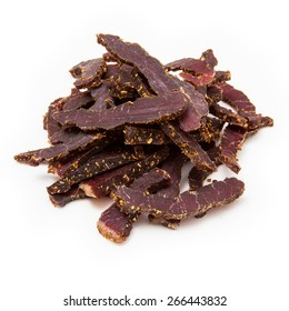 Biltong South African beef jerky isolated on a white studio background.