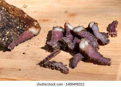Biltong - Traditional South African Jerky made from beef or game meat, cured and dried with salt and spices; eaten uncooked, often as a snack.