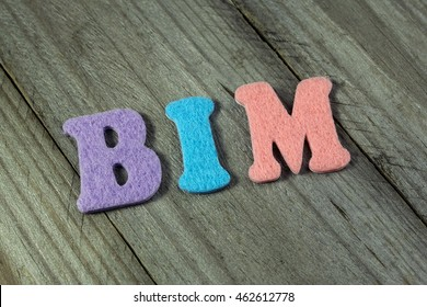 BIM (Building Information Modeling) acronym on wooden background