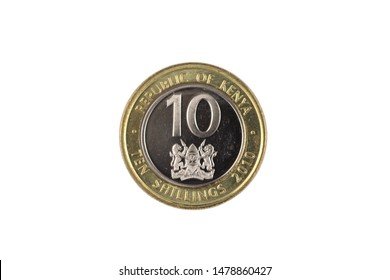 A bimettalic, ten Kenyan shilling coin isolated on a white background, shot in close up macro