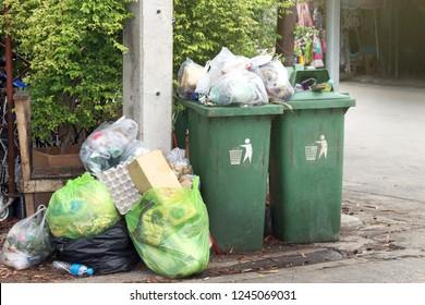 bin, garbage is pile lots dump, many garbage plastic bags black waste at walkway community village, pollution from trash plastic waste garbage, bags bin of plastic waste, garbage waste lots junk dump