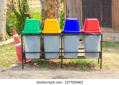 Bin, green, blue, yellow and red recycle bins with recycle waste symbol, Four colorful recycle bins garbage in garden, Plastic Bin garbage waste separation, Front view four recycle bin