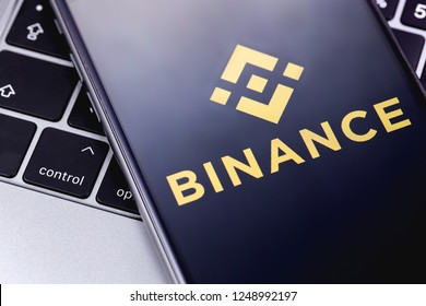 Binance logo on the screen smartphone snd notebook. Binance - one of the largest cryptocurrency exchange on the market. Moscow, Russia - December 4, 2018