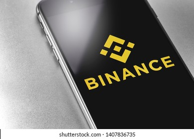 Binance logo on the screen smartphone. Binance - one of the largest cryptocurrency exchange on the market. Moscow, Russia - May 20, 2018