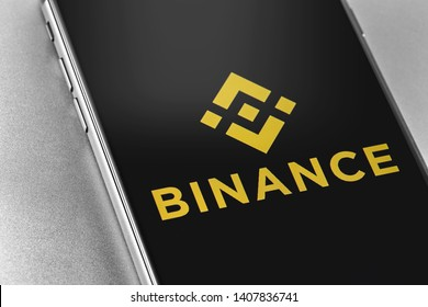 Binance logo on the screen smartphone closeup. Binance - one of the largest cryptocurrency exchange on the market. Moscow, Russia - May 20, 2018