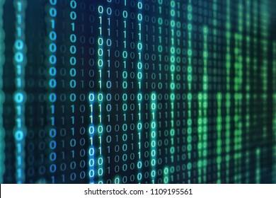 binary code data bit screen display on laptop computer screen. matrix of data flow. Rise of the big data AI age. artificial intelligence data transfer. Digital concept, high tech defocused blue light