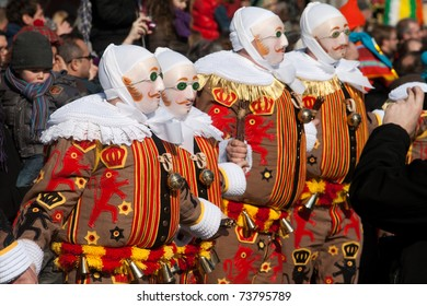 BINCHE, BELGIUM - MARCH 8: Gilles in mask performs round dance at Carnaval de Binche on March 8, 2011 in Binche, Belgium. Carnival in Binche is included in a list of intangible heritage by UNESCO.