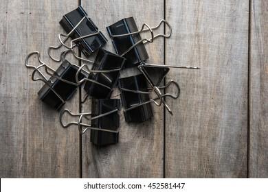 Binder Paper clip on old wooden background