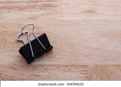 Binder Paper clip on wooden background