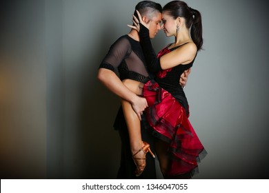 a binding element for the composition of ballroom dancing, cha cha, rumba or pasodoble. partner beautifully embracing a woman in the dance.